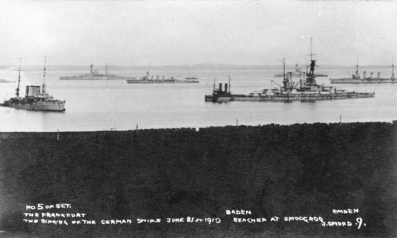 HMS Resolution lying off the beached German ships, Frankfirt, Baden and Emden. Orkney Library & Archive.
