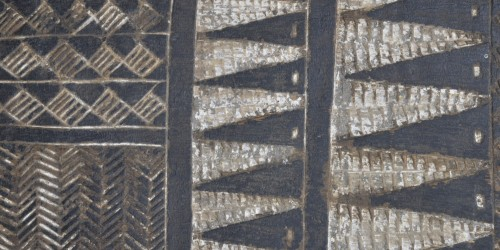 Geometric decoration on a dance paddle from the Mortlock Islands